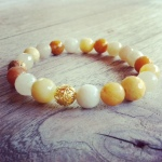 Jade is considered the health, wealth and longevity stone. Yellow Jade is energetic and stimulating, yet mellow. It brings joy and happiness and teaches the interconnectedness of all beings. Yellow Jade aids the digestive and elimination systems of the body.