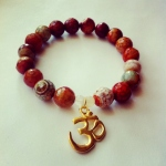 Gemstone Bracelet Sedona Orange Agate with Moonstone and Gold OM Charm. You can find it here